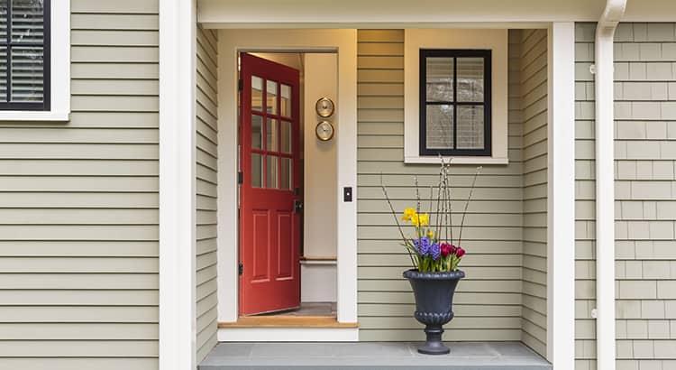 Open front door to classic style home.